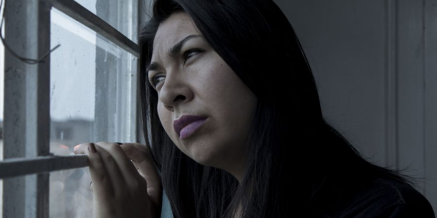 Woman feeling a lack of control and sadness in her life