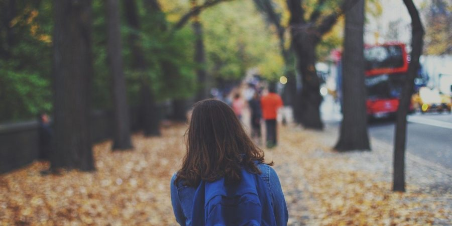 girl standing outside school worried about grades