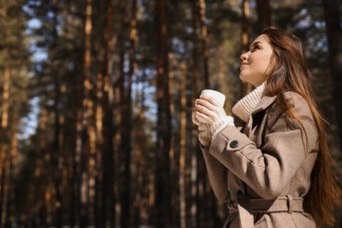 Woman who is overcoming overload by visiting the forest